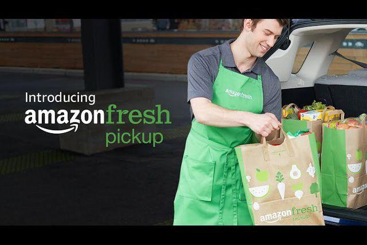 """<img alt=""""""""/><div> <p></p>    </div> <p>AmazonFresh already delivers groceries to your house or apartment.</p> <p>Now add your car to that list. Amazon on Tuesday announced the launch of <a rel=""""nofollow"""" href=""""https://www.amazon.com/afx/nc/aboutpickup"""">AmazonFresh Pickup</a>, which is basically curbside pickup at an Amazon grocery store.</p> <p>To get your groceries via AmazonFresh Pickup, you place an order through the Amazon app and reserve a time for pickup. According to the <a rel=""""nofollow"""" href=""""https://www.youtube.com/watch?v=3Qge56XV2_A&feature=youtu.be"""">video</a> announcing the service, at least, a friendly person wearing an AmazonFresh apron will bag your groceries and put them in your trunk. There's no minimum order.</p> <div><p>SEE ALSO: <a rel=""""nofollow"""" href=""""http://mashable.com/2017/02/21/amazon-go-alcohol/?utm_campaign=Mash-BD-Synd-Yahoo-Bus-Full&utm_cid=Mash-BD-Synd-Yahoo-Bus-Full"""">Amazon's high-tech grocery store will let you grab a beer and walk out (almost)</a></p></div> <p>Just like <a rel=""""nofollow"""" href=""""http://mashable.com/2016/12/05/amazon-go-shopping/?utm_campaign=Mash-BD-Synd-Yahoo-Bus-Full&utm_cid=Mash-BD-Synd-Yahoo-Bus-Full"""">Amazon Go</a>, Amazon's cashier-less grocery store of the future, AmazonFresh Pickup is currently open in beta for Amazon employees in Seattle. When the service launches for real, all Prime members will be able to use the two Seattle locations without an extra charge. Amazon didn't say when the service would expand beyond Seattle.</p> <p>Unlike regular AmazonFresh, AmazonFresh Pickup will be free for all Prime members. Prime customers who pay the extra monthly fee for the ability to order AmazonFresh home delivery will be able to pick up their groceries faster if they opt to do pickup instead.</p> <div><p>SEE ALSO: <a rel=""""nofollow"""" href=""""http://mashable.com/2017/01/06/food-stamps-online-grocery-amazon/?utm_campaign=Mash-BD-Synd-Yahoo-Bus-Full&utm_cid=Mash-BD-Synd-Yahoo-Bus-Full"""">Amazon, FreshDirect will start accep"""