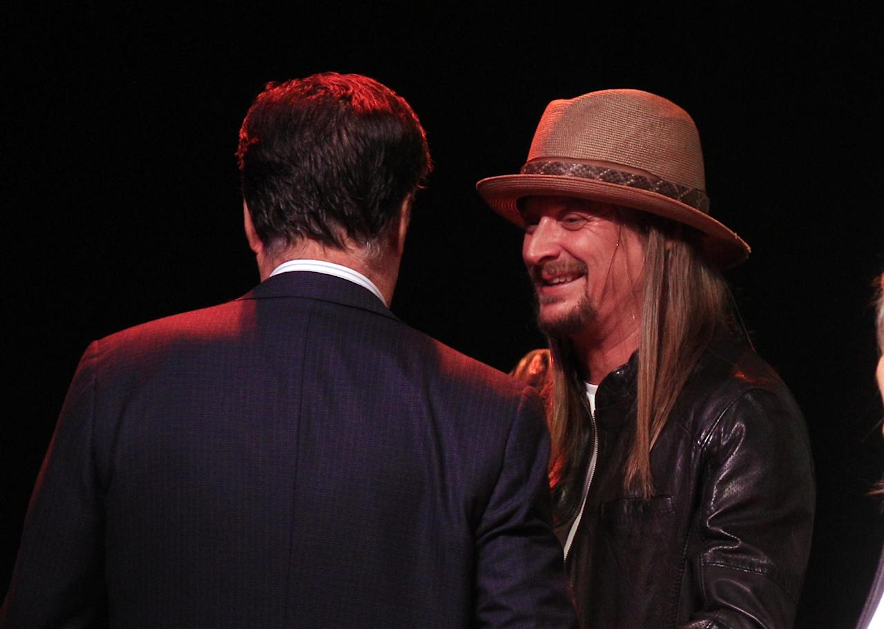 Republican presidential candidate, former Massachusetts Gov. Mitt Romney, meets with Kid Rock after addressing supporters at the Royal Oak Music Theatre in Royal Oak, Mich., Monday, Feb. 27, 2012. (AP Photo/Carlos Osorio)