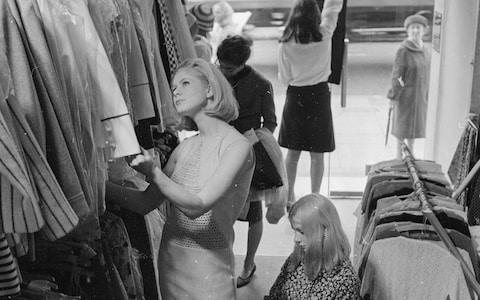 Shoppers at a King's Road boutique - Credit: GETTY