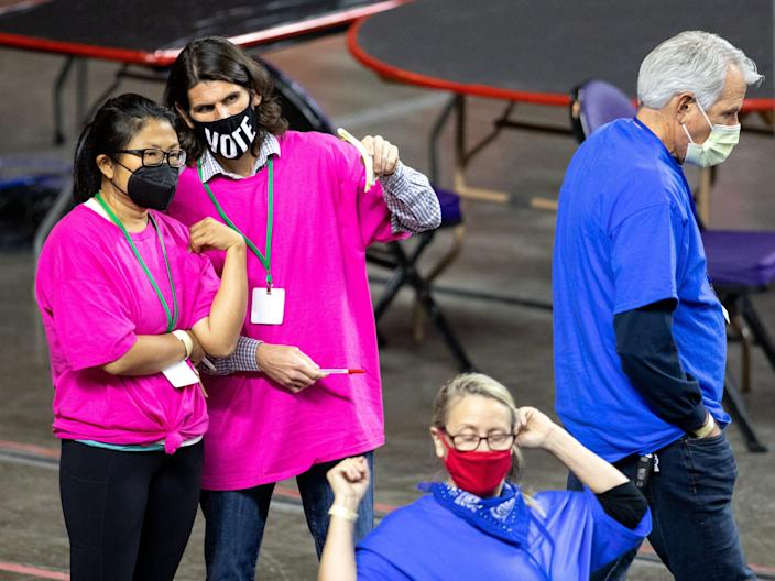 Ballots from the 2020 general election are being examined and recounted at Veterans Memorial Coliseum on May 1, 2021 in Phoenix, Arizona.  (Getty Images)