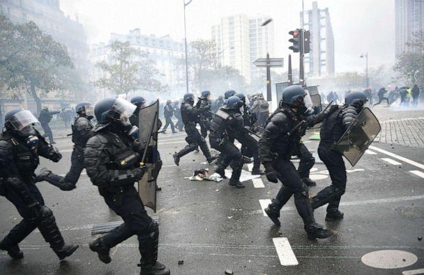 PHOTO: Riot mobile gendarmes run on place d'Italie in Paris on November 16, 2019, during a demonstration of the 'yellow vest' (gilets jaunes) marking the first anniversary of the movement. (Martin Bureau/AFP via Getty Images)