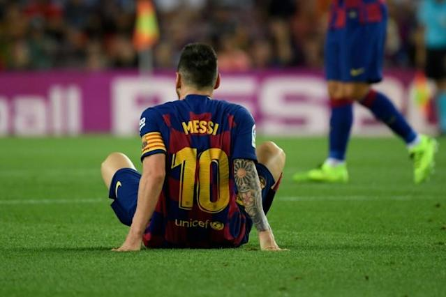 Lionel Messi went off at half-time during Barcelona's 2-1 win over Villarreal on Tuesday. (AFP Photo/LLUIS GENE)
