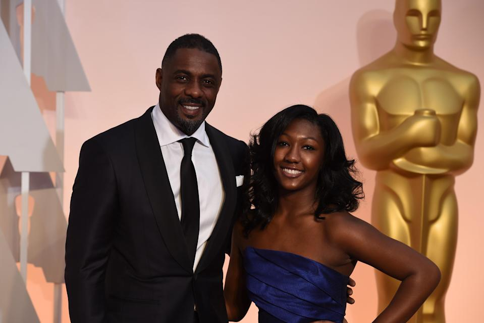 "Idris Elba and his daughter, Isan, at the 2015 Oscars. ""Issy,"" as the actor calls her, has been named the 2019 Golden Globe ambassador. (Photo: Mark Ralston/AFP/Getty Images)"