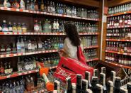 A customer shops for alcoholic beverages at a supermarket in Istanbul