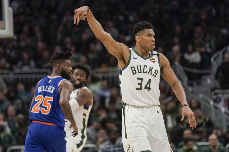 Milwaukee Bucks' Giannis Antetokounmpo reacts to his three-point basket during the second half of an NBA basketball game against the New York Knicks Tuesday, Jan. 14, 2020, in Milwaukee. (AP Photo/Morry Gash)