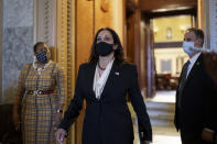 Vice President-elect Sen. Kamala Harris, D-Calif., strides from the Senate chamber after voting against President Donald Trump's controversial choice for the Federal Reserve Board of Governors, Judy Shelton, at the Capitol in Washington, Tuesday, Nov. 17, 2020. (AP Photo/J. Scott Applewhite)
