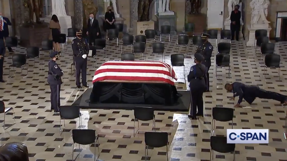 Ruth Bader Ginsburg's trainer, Army reservist Bryant Johnson, does a set of pushups while the former justice's body lay in state. (Photo: Twitter)