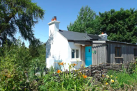 """<p>Birch Cottage sits at the centre of Lackan Cottage Farm — a rural six-acre organic smallholding in the heart of the South Down countryside. Powered entirely by renewable energy on site, it's a cosy escape all can enjoy. </p><p><a class=""""link rapid-noclick-resp"""" href=""""https://airbnb.pvxt.net/WDqmB3"""" rel=""""nofollow noopener"""" target=""""_blank"""" data-ylk=""""slk:BOOK NOW"""">BOOK NOW</a></p>"""