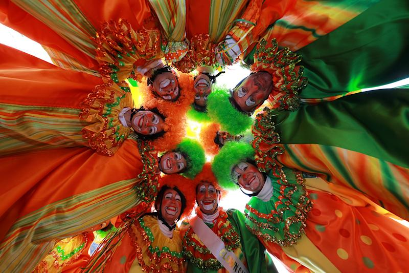 The Hi-Roller Skating Clowns gather in a circle above the photographer before in the 93rd Macy's Thanksgiving Day Parade in New York, Nov. 28, 2019. (Photo: Gordon Donovan/Yahoo News)