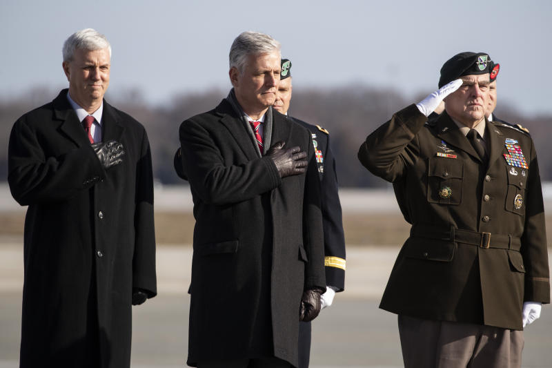 Acting Under Secretary of the Army James McPherson, left, National Security Adviser Robert O'Brien, Joint Chiefs Chairman Gen. Mark Milley and others, stand as an Army carry team moves a transfer case containing the remains of U.S. Army Sgt. 1st Class Michael Goble, Wednesday, Dec. 25, 2019, at Dover Air Force Base, Del. According to the Department of Defense, Goble, of Washington Township, N.J., assigned to the 7th Special Forces Group, died while supporting Operation Freedom's Sentinel. (AP Photo/Alex Brandon)