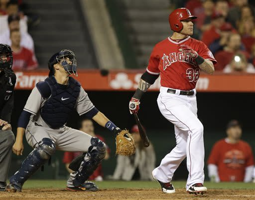 Los Angeles Angels' Josh Hamilton, right, watches his home run as Houston Astros catcher Jason Castro looks on during the sixth inning of a baseball game in Anaheim, Calif., Saturday, April 13, 2013. (AP Photo/Chris Carlson)