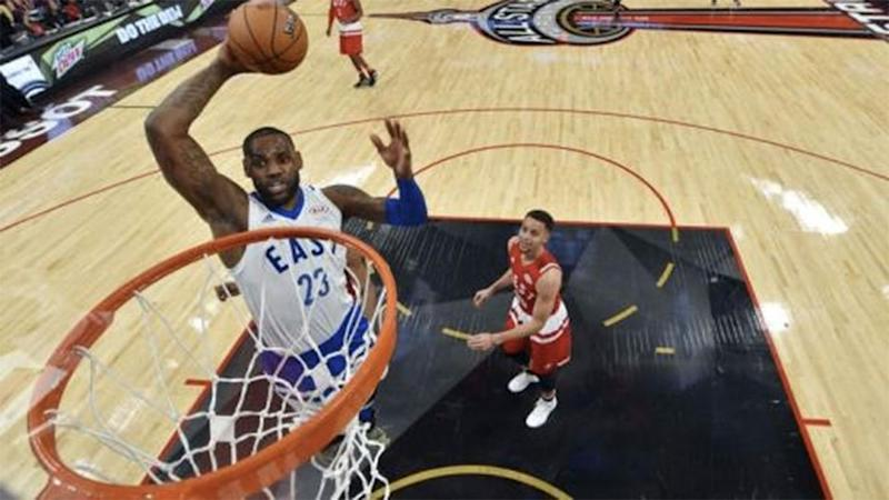LeBron James of the Cleveland Cavaliers goes up for a dunk during the NBA All-Star Game in Toronto. Photo: Reuters