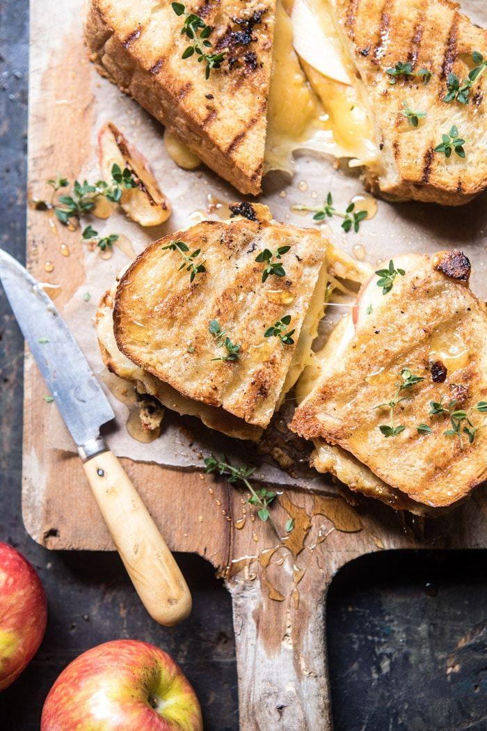 "<p>Trust us—you'll want to spread the homemade apple butter on both sides of this toasty sandwich.</p><p><strong>Get the recipe at <a href=""https://www.halfbakedharvest.com/honey-apple-cheddar-and-bacon-panini/"" rel=""nofollow noopener"" target=""_blank"" data-ylk=""slk:Half Baked Harvest"" class=""link rapid-noclick-resp"">Half Baked Harvest</a>.</strong></p><p><a class=""link rapid-noclick-resp"" href=""https://www.amazon.com/Hamilton-Beach-25462Z-Gourmet-Sandwich/dp/B00E134JJ0?tag=syn-yahoo-20&ascsubtag=%5Bartid%7C10050.g.650%5Bsrc%7Cyahoo-us"" rel=""nofollow noopener"" target=""_blank"" data-ylk=""slk:SHOP PANINI PRESSES"">SHOP PANINI PRESSES</a></p>"