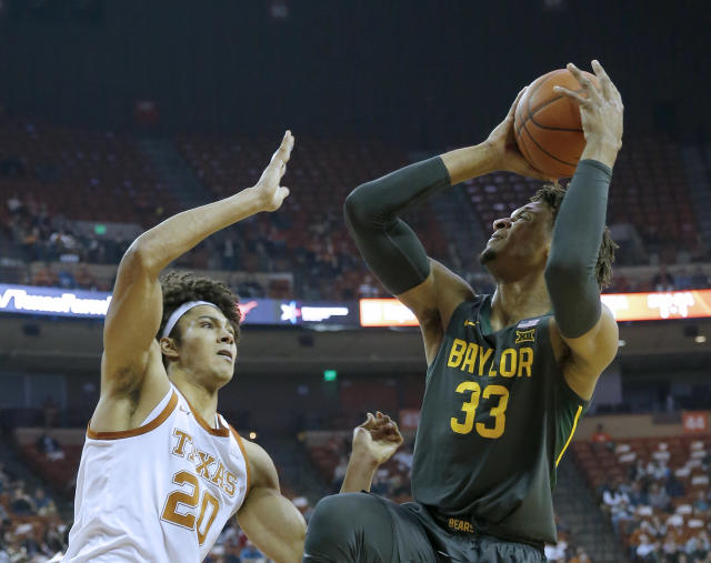 Baylor's Freddie Gillespie shoots over Jericho Sims of the Texas Longhorns on Feb. 10. (Chris Covatta/Getty Images)