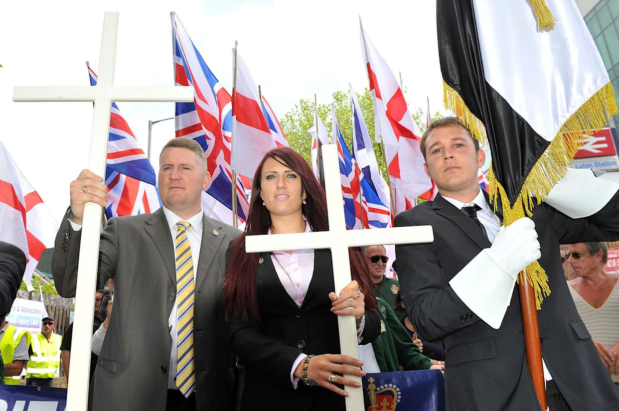 Golding, left, and Fransen, center, join a British First protest march at Bury Park on June 27, 2015, in Luton, England. (Photo: Tony Margiocchi/Barcroft Media via Getty Images)