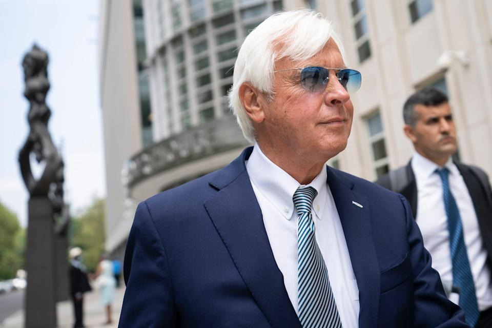 Bob Baffert leaves federal court, Monday, July 12, 2021, in the Brooklyn borough of New York. A New York federal judge seems sympathetic to Baffert's claims that his May suspension by the New York Racing Association was unconstitutional after Kentucky Derby winner Medina Spirit failed a postrace drug test.