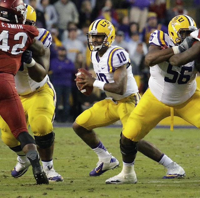 LSU Tigers quarterback Anthony Jennings (10) scrambles against Arkansas in the second half of an NCAA college football game in Baton Rouge, La., Friday, Nov. 29, 2013. LSU defeated Arkansas 31-27. (AP Photo/Bill Haber)