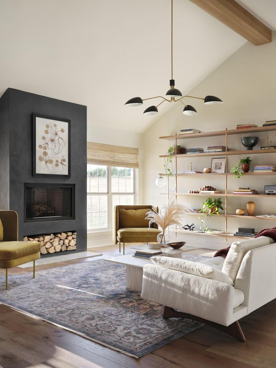 <p>During the reveal, Lucas and Laney could hardly believe this was the same living room. The eyesore fireplace turned into the focal point of the whole room, as Chip and Joanna had resurfaced it in dark plaster to modernize the space and create a contrast with the white walls.</p>