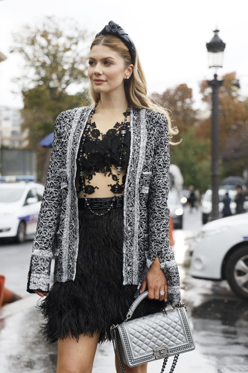 PARIS, FRANCE - OCTOBER 01: A guest wearing Chanel jacket and bag outside the Chanel show during Paris Fashion Week Womenswear Spring Summer 2020 on October 01, 2019 in Paris, France. (Photo by Hanna Lassen/Getty Images)