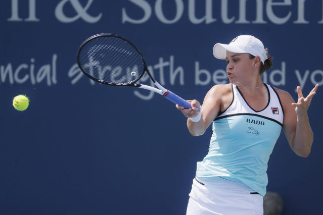 Ashleigh Barty, of Australia, returns to Anett Kontaveit, of Estonia, during the quarterfinals of the Western & Southern Open tennis tournament, Thursday, Aug. 15, 2019, in Mason, Ohio. (AP Photo/John Minchillo)