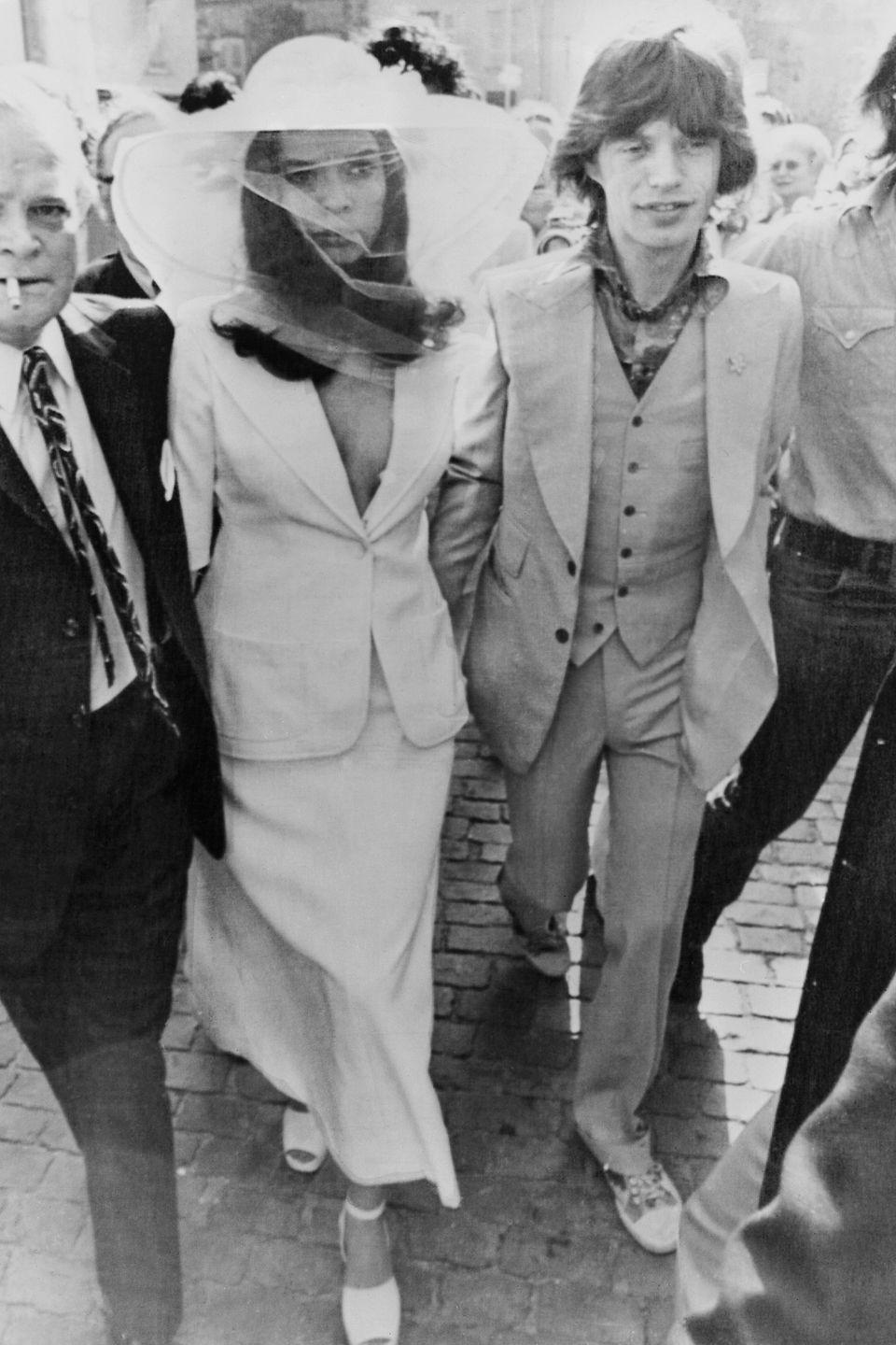 <p>Bianca Jagger wore a chic blazer and hat with a veil for her intimate wedding ceremony to Rolling Stones singer Mick Jagger in Saint Tropez's City Hall. </p>