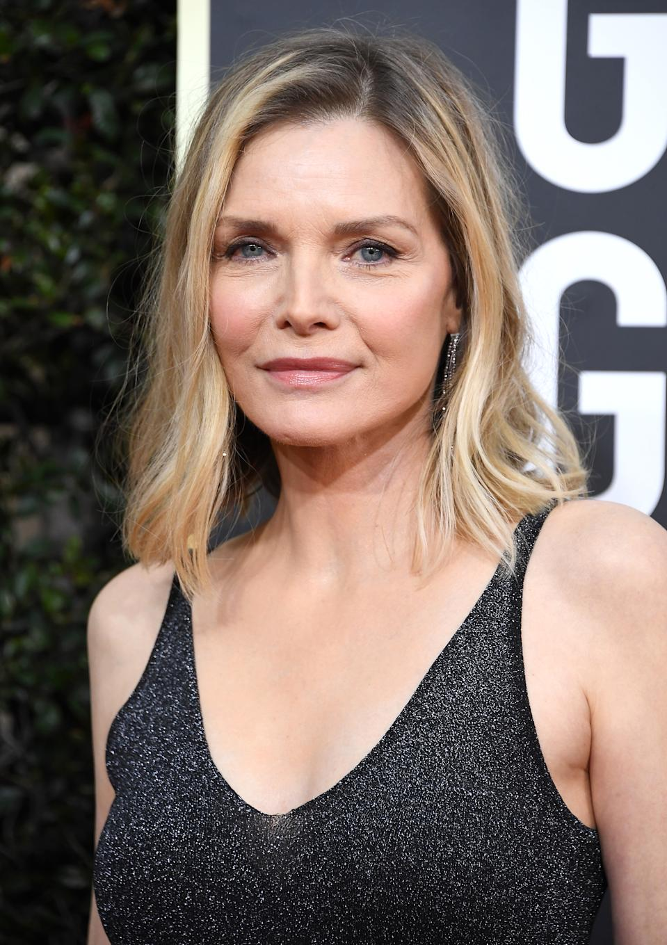 Michelle Pfeiffer wears a black strappy dress at the 77th Annual Golden Globe Awards at The Beverly Hilton Hotel on January 05, 2020 in Beverly Hills, California.