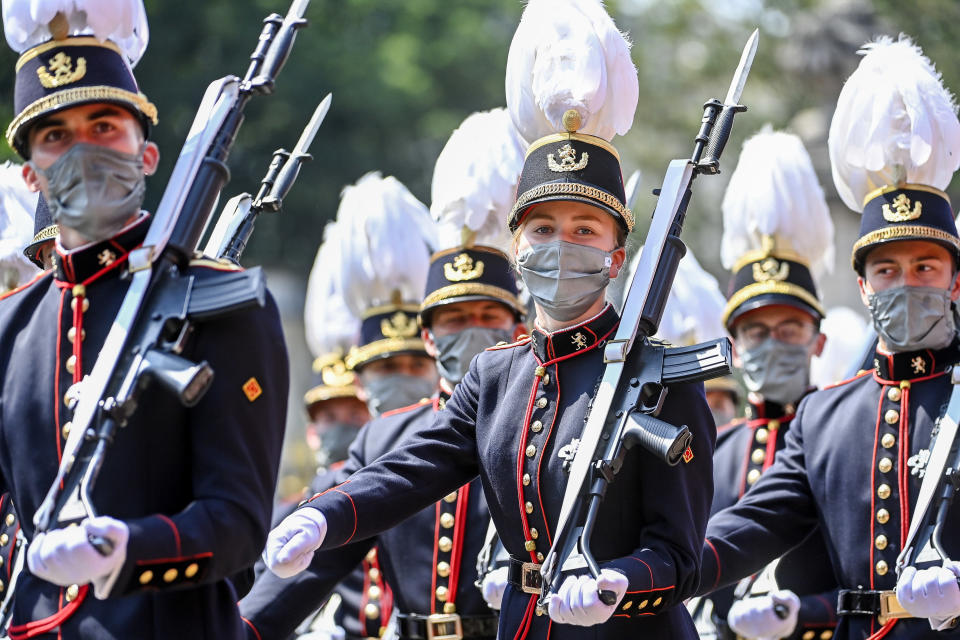 Belgium's Crown Princess Elisabeth, center, marches past the Royal tribune with cadets of the military school during the National Day parade in Brussels, Wednesday, July 21, 2021. Belgium celebrates its National Day on Wednesday in a scaled down version due to coronavirus, COVID-19 measures. (Laurie Dieffembacq, Pool Photo via AP)