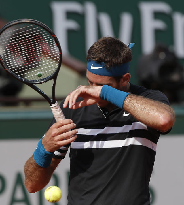Argentina's Juan Martin del Potro wipes the sweat off his face in his semifinal match of the French Open tennis tournament against Spain's Rafael Nadal at the Roland Garros stadium in Paris, France, Friday, June 8, 2018. (AP Photo/Michel Euler)