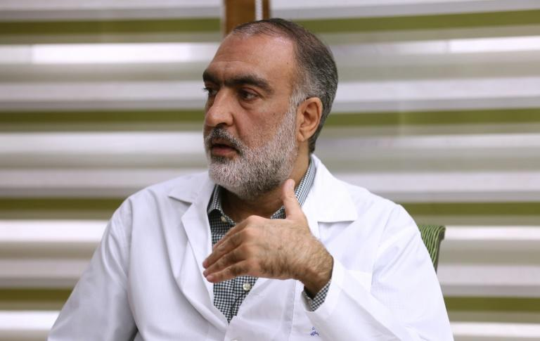Iranian Mohammad Rezaei, the deputy director of pharmacies attached to the Tehran University of Medical Sciences, says insulin stocks are depleting (AFP Photo/ATTA KENARE)
