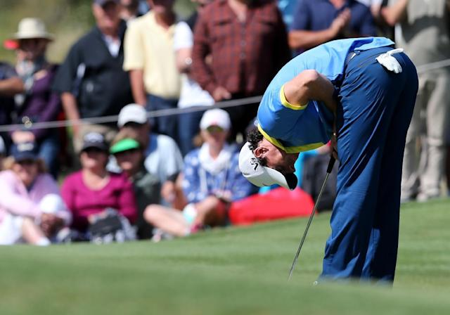 Rory McIlroy of Northern Ireland reacts after a missed putt during his third round of the Australian Open Golf tournament in Sydney, Australia, Saturday, Nov. 30, 2013.(AP Photo/Rob Griffith)