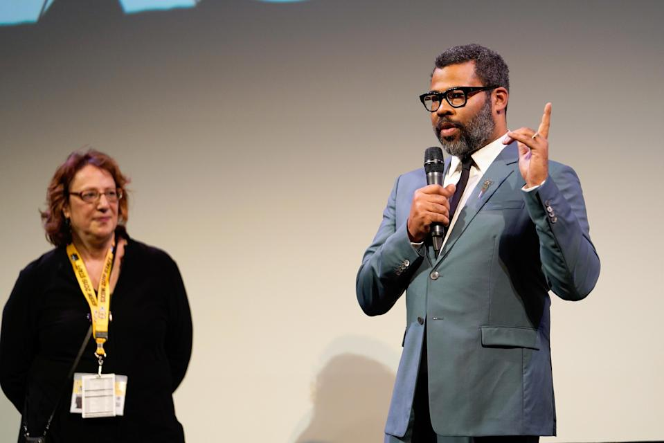 SXSW Film director Janet Pierson and Jordan Peele (R) speak onstage during the 'Us' Premiere during the 2019 SXSW Conference and Festivals at Paramount Theatre on March 8, 2019 in Austin, Texas. (Ismael Quintanilla/Getty Images for SXSW)