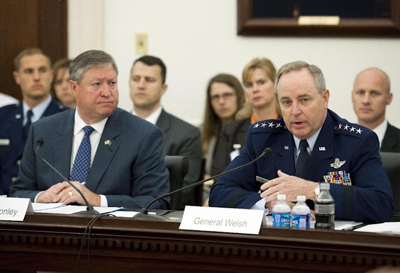 """FILE – In this May 9, 2013, file photo Air Force Secretary Michael Donley, left, and Air Force Chief of Staff Gen. Mark Welsh III testify at a Capitol Hill hearing on the defense budget for the Air Force in Washington. Following the Air Force's embarrassing removal of 17 nuclear missile launch officers Donley says he worries that talk of further shrinking of the nation's nuclear force is having a """"corrosive effect"""" on the service. (AP Photo/Cliff Owen, File)"""