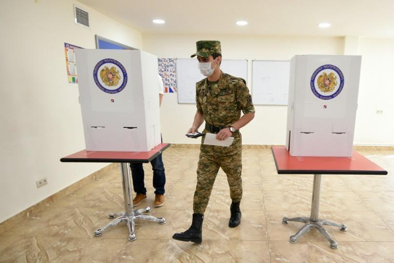 A soldier votes: More than 6,500 people were killed in the war