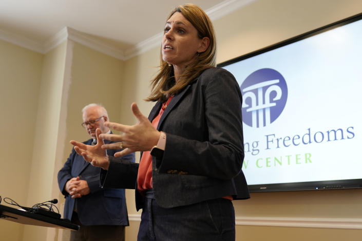 Victoria Cobb, of The Family Foundation, speaks during a news conference at the foundation offices in Richmond, Va., Tuesday, March 30, 2021. Cobb announced the filing of a lawsuit challenging the state Department of Education's newly issued guidelines on the treatment of transgender students. (AP Photo/Steve Helber)