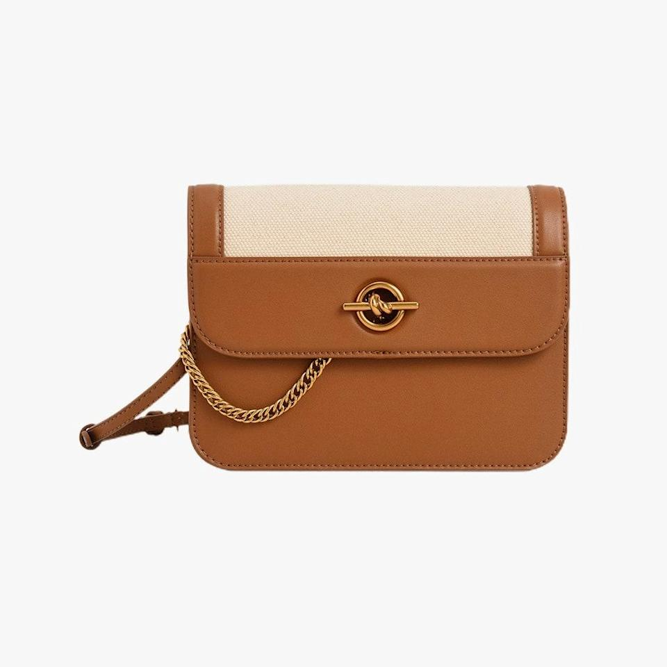 """$63, CHARLES & KEITH. <a href=""""https://www.charleskeith.com/us/bags/CK2-80270640_IVORY.html"""" rel=""""nofollow noopener"""" target=""""_blank"""" data-ylk=""""slk:Get it now!"""" class=""""link rapid-noclick-resp"""">Get it now!</a>"""