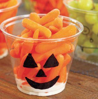 """<p>This craft is just as simple as taking a magic marker to a plastic cup and drawing a Jack-o-Lantern. </p><p><a href=""""https://www.womansday.com/home/decorating/a28903299/crafty-containers/"""" rel=""""nofollow noopener"""" target=""""_blank"""" data-ylk=""""slk:Get the Crafty Containers tutorial."""" class=""""link rapid-noclick-resp""""><strong><em>Get the Crafty Containers tutorial. </em></strong> </a></p>"""
