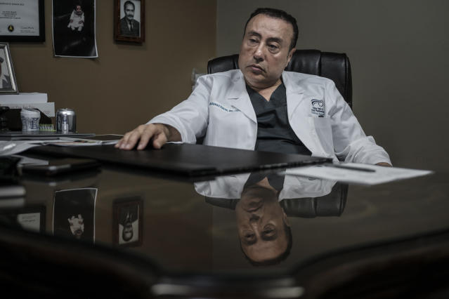 Dr. Mohamad Hakim in his office in Dearborn. (Sean Proctor for HuffPost)