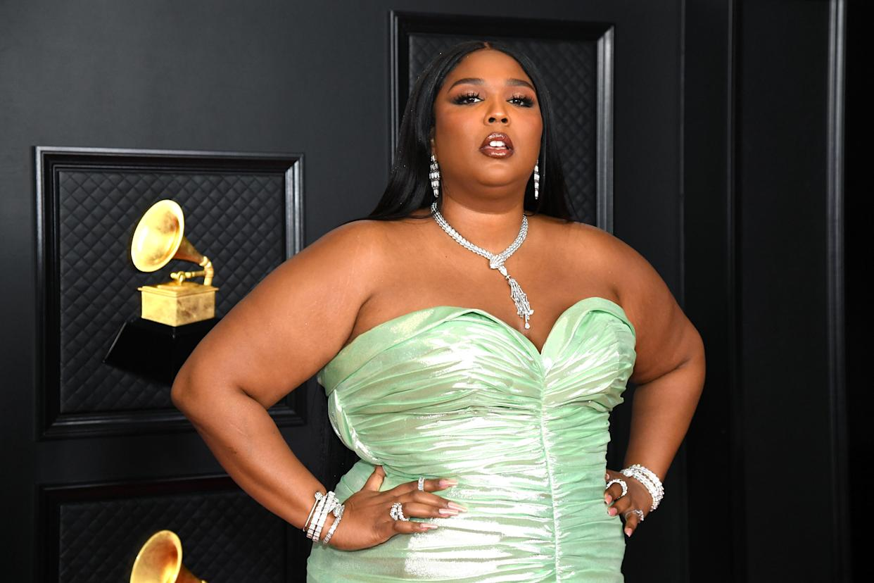 Singer Lizzo, 33, spiced up social media on Saturday with a sultry series of photos of herself sporting lime green hair and a rhinestone bra top. (Photo: Kevin Mazur/Getty Images for The Recording Academy)