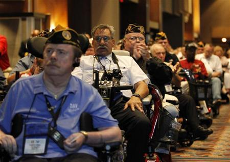 Disabled U.S. veterans listen to President Obama at the National Convention of Disabled American Veterans in Atlanta