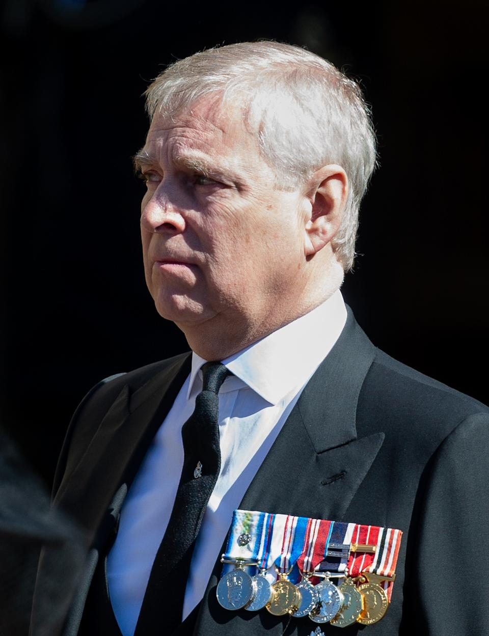 WINDSOR, ENGLAND - APRIL 17: Prince Andrew, Duke of York looks on as the coffin of Prince Philip, Duke of Edinburgh arrives St George's Chapel in a purpose build Land Rover during the funeral of Prince Philip, Duke of Edinburgh on April 17, 2021 in Windsor, England. Prince Philip of Greece and Denmark was born 10 June 1921, in Greece. He served in the British Royal Navy and fought in WWII. He married the then Princess Elizabeth on 20 November 1947 and was created Duke of Edinburgh, Earl of Merioneth, and Baron Greenwich by King VI. He served as Prince Consort to Queen Elizabeth II until his death on April 9 2021, months short of his 100th birthday. His funeral takes place today at Windsor Castle with only 30 guests invited due to Coronavirus pandemic restrictions. (Photo by Pool/Samir Hussein/WireImage)