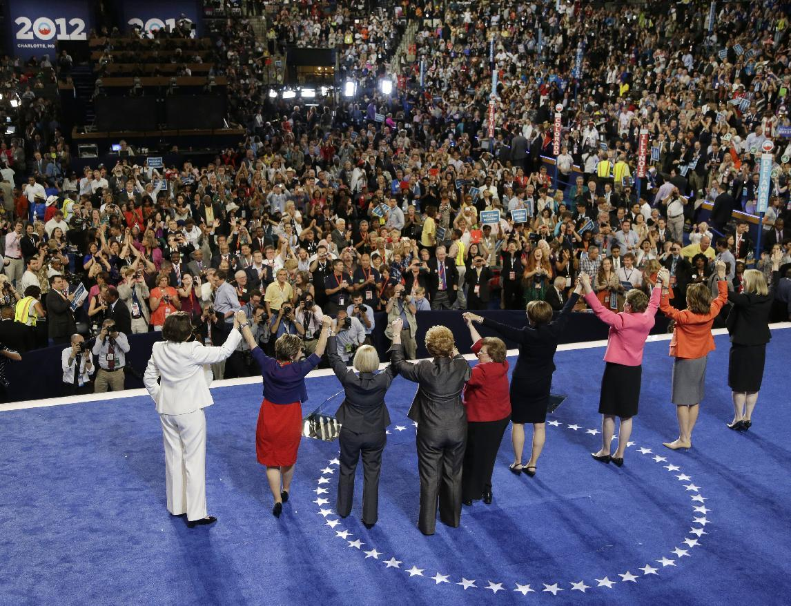 Women from the US Senate hold hands after Sen. Barbara Mikulski of Maryland's speech at the Democratic National Convention in Charlotte, N.C., on Wednesday, Sept. 5, 2012. (AP Photo/Charlie Neibergall)