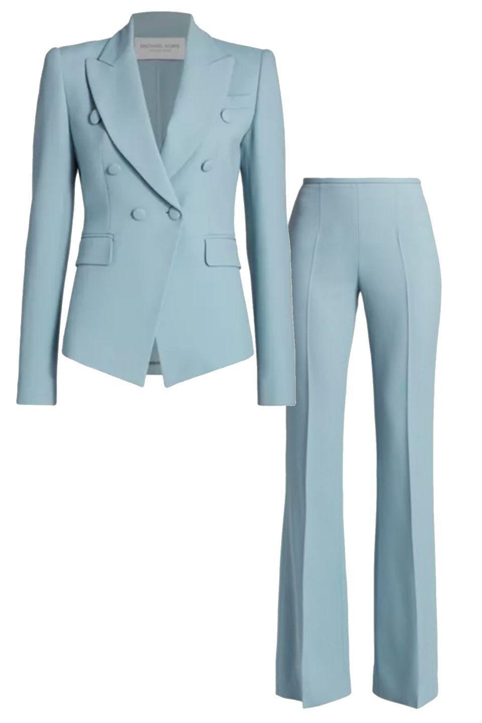 """<p>The cut of this eggshell blue Michael Kors suit set accentuates the leg and tailors the waist for an extremely becoming silhouette. <br></p><p><a href=""""https://go.skimresources.com?id=74968X1525087&xs=1&url=https%3A%2F%2Fwww.saksfifthavenue.com%2Fmichael-kors-collection-double-crepe-double-breasted-blazer%2Fproduct%2F0400012642323%3FFOLDER%253C%253Efolder_id%3D2534374306646244%26R%3D190417530440%26P_name%3DMichael%2BKors%2BCollection%26N%3D306646244%2B4294929615%2B4294929614%2B4294929610%2B4294929600%2B4294929616%26bmUID%3DniiGA8P"""" rel=""""nofollow noopener"""" target=""""_blank"""" data-ylk=""""slk:Michael Kors Blazer"""" class=""""link rapid-noclick-resp""""><br>Michael Kors Blazer</a><a href=""""https://go.skimresources.com?id=74968X1525087&xs=1&url=https%3A%2F%2Fwww.saksfifthavenue.com%2Fmichael-kors-collection-brooke-double-crepe-flare-pants%2Fproduct%2F0400012641119%3FclickType%3DPRODUCT_RECOMMENDATIONS"""" rel=""""nofollow noopener"""" target=""""_blank"""" data-ylk=""""slk:Michael Kors Pant"""" class=""""link rapid-noclick-resp""""><br>Michael Kors Pant</a></p>"""