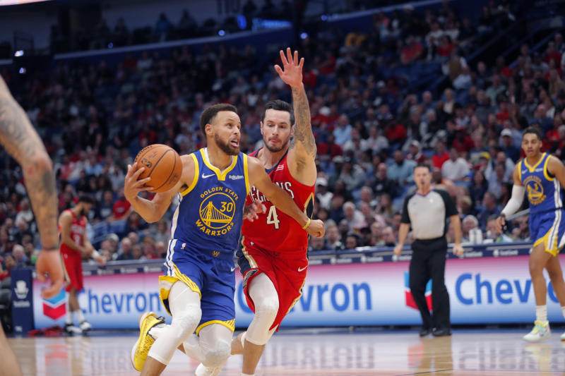 Golden State Warriors guard Stephen Curry (30) drives to the basket against New Orleans Pelicans guard JJ Redick (4) in the first half of an NBA basketball game in New Orleans, Monday, Oct. 28, 2019. (AP Photo/Gerald Herbert)