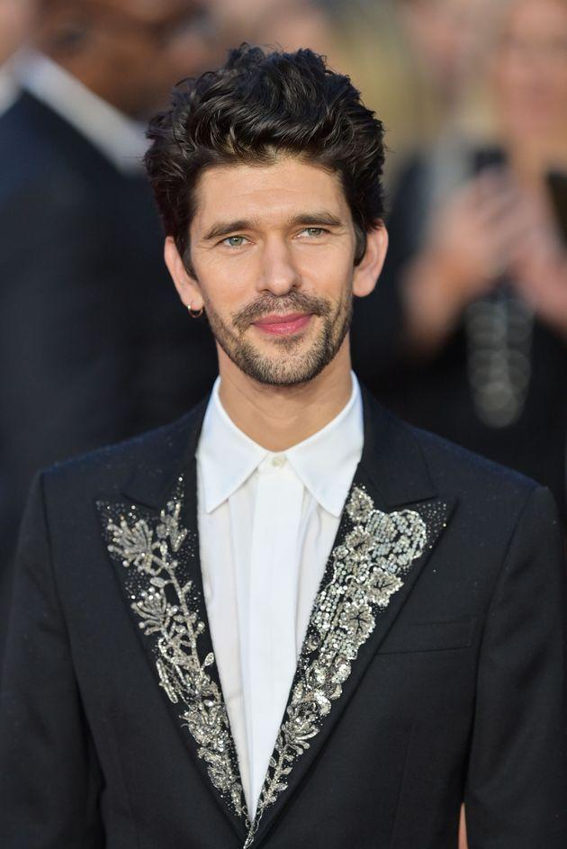 Ben Whishaw, in a jeweled jacket, smiles for the cameras. (Photo: Samir Hussein via Getty Images)