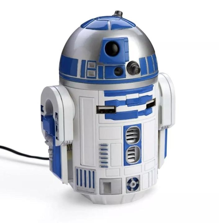 <p>R2 units are the ultimate helpers, and this <span>Star Wars R2-D2 USB Car Charger</span> ($65) is no exception. The charger sits in a cup holder and plugs into a cigarette lighter. It can charge up to two USB devices at once, and R2's dome even rotates and lights up. When power is connected, the bot will whistle and beep.</p>