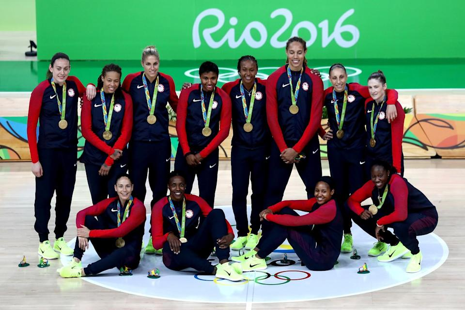 <p>Gold medalists Team USA celebrate during the medal ceremony after the Women's Basketball competition on Day 15 of the Rio 2016 Olympic Games at Carioca Arena 1 on August 20, 2016 in Rio de Janeiro, Brazil. (Photo by Sean M. Haffey/Getty Images) </p>