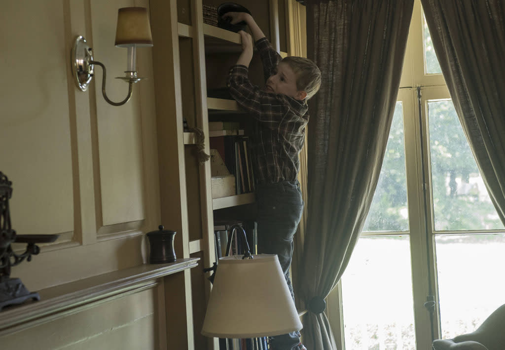 """Joey Matthews (Kyle Catlett) tries to reach for a hidden phone in the """"Mad Love"""" episode of """"The Following."""""""