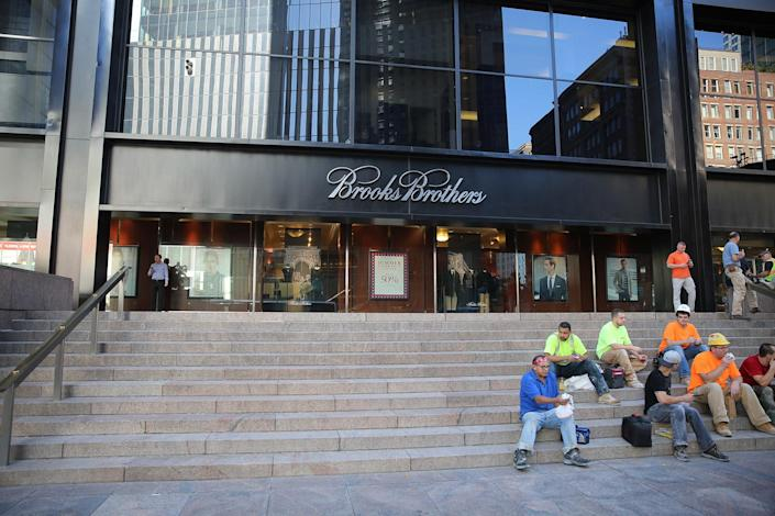 <p>Workers take a break on the steps of Brooks Brothers across from the World Trade Center site in New York City, Aug. 23, 2016. (Gordon Donovan/Yahoo News) </p>