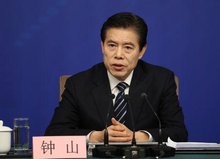 Chinese Commerce Minister Zhong Shan attends a news conference on the sidelines of the National People's Congress (NPC) in Beijing