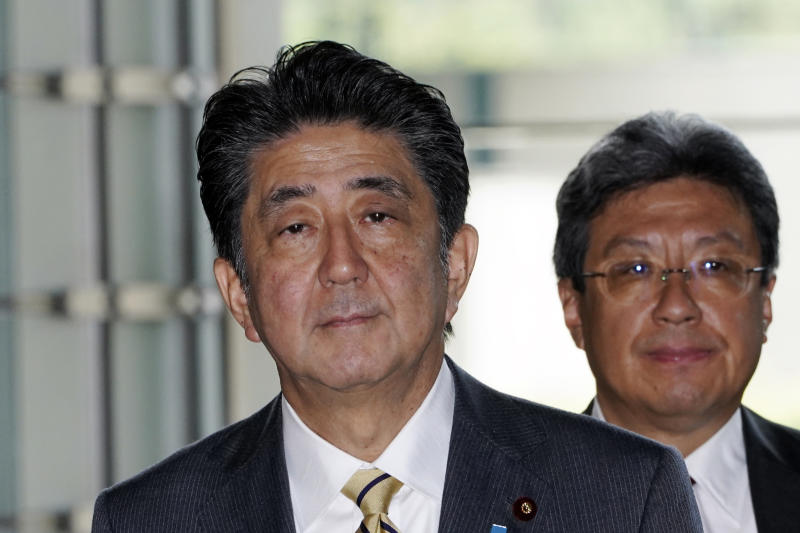 Japanese Prime Minister Shinzo Abe enters his official residence in Tokyo Wednesday, Sept. 11, 2019. Abe will reshuffle his Cabinet in a move that's likely to impact key issues including tensions with South Korea. (AP Photo/Eugene Hoshiko)